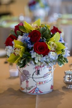 Wrap buckets in scrapbook paper for an easy, DIY customizable centerpiece.  This craft is so simple!