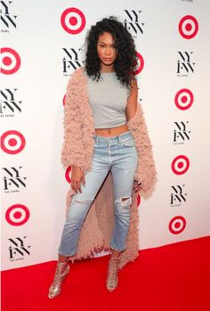 Model Chanel Iman paired blue ripped jeans with a crop top and pink faux fur coat.  Read more about the latest FROW action from New York Fashion Week here: http://lifestyle.one/grazia/fashion/news/new-york-fashion-week-front-row-parties/