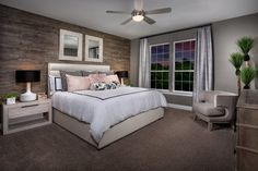 Give your bedroom a rustic feel with a wood feature wall for a bit of log cabin chic.