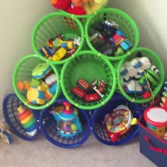 $11.00 toy storage I made in less than an hour.  Dollar store baskets and zip ties!!!
