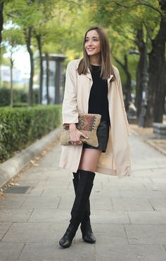 trench coat with black leatherette shorts and a sweater in the same color + over the knee black boots by Zara