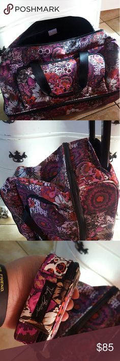 Vera Bradley Lighten Up Wheeled Carry on  bundle Print is Rosewood. BNWOT. Never used. Comes with the matching travel pill container. Retails for $198.   DESCRIPTION This lightweight, colorful, carry on luggage piece includes two large zip-around compartments so that you can pack shoes separately from clothes.  DETAILS & CARE TIPS Lightweight, durable and water-resistant 560D polyester Front zip-around pocket includes one zip and two slip mesh pockets Second separate compartment is perfect…