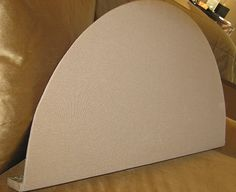 Crescent shaped board fits into the arched window above the roman blind