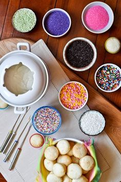 Cupcake fondue - guests dip their mini cupcake in frosting and then choose their topping