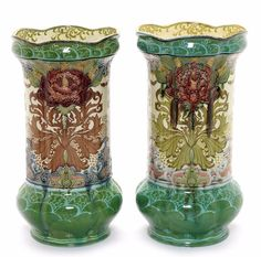Minton a Large Pair of Art Nouveau Vases, circa 1910, printed and decorated in relief with red floral blooms and brown and green foliage, 57cm high, maker's marks  |  SOLD $2,510 London, April 2013