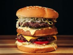 The McWhopper Burger King's marketing team has always been better than its culinary team, and their latest publicity stunt is one of the best I've ever seen. Their proposal? That on September World Peace Day, Burger King and arch-rival McDonald's bur Hamburgers, Cheeseburgers, Mcdonalds, Pizza Hamburger, Hamburger Recipes, Grilled Burger Recipes, Gourmet Burgers, Grilling Burgers, Big Burgers