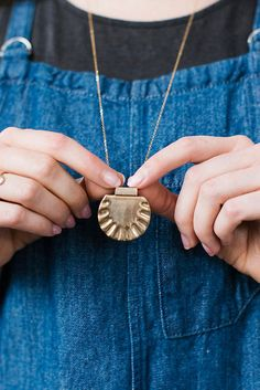 Warm up your look with a sun-inspired necklace.