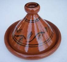 Cooking Tagine 10.5 inch wide ,by Treasure Of Morocco by Treasures Of Morocco. $37.99. This is an authentic, handcrafted Moroccan cooking tagine. Imported from Morocco. Morocan cooking ware. Every day use. 10.5Inches wide. Simple and functional, this authentic, handcrafted Moroccan cooking Tagine is ready to be used for your next flavorful and exotic Moroccan meal.The Tagine is to be use on the top of electrical or glass stove or inside the stove. If you have a...
