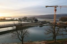 Raymond Vogel Landschaften designed and constructed a completely new landscape around the new Hydropower Plant in Hagneck, Lake of Biel/Switzerland #construction #landscapearchitecture #crane