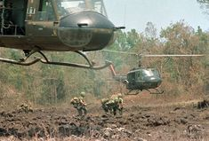 VIETNAM WAR - U.S. PARATROOPERS | A helicopter hovers over the field, ready to load personnel and equipment during Operation Masher in the Vietnam War, May 7, 1966. (AP Photo) Flickr - Photo Sharing!