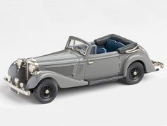 Jensen S-Type 3.5 Litre Convertible (1937) Diecast Model Car by Brooklin Models LDM103 This Jensen S-Type 3.5 Litre Convertible (1937) Diecast Model Car is Grey and features working wheels. It is made by Brooklin Models and is 1:43 scale (approx. 11cm / 4.3in long).  British styling combined with large American engines proved popular. Jensen was one of a number of small companies to use this formula along with Railton, Atalanta and Allard. The S Type usually used a Ford V8 of just over 3…