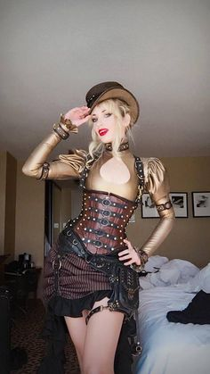 Amy Wilder as Golden Steampunk Showgirl - For costume tutorials, clothing guide, fashion inspiration photo gallery, calendar of Steampunk events, & more, visit SteampunkFashionGuide.com