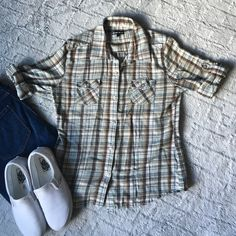 Selling this Vans plaid Flannel in my Poshmark closet! My username is: cyndyx3. #shopmycloset #poshmark #fashion #shopping #style #forsale #Vans #Tops
