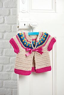 This cosy and throughly adorable short-sleeved cardigan is the perfect summer cover-up for little ones. The super-soft wool and alpaca mix is reasonable and there are lots of lovely shades to choose from. The cardi has a bright yoke that mimics its knitted Fair Isle cousins and is fastened with a shiny satin ribbon. What more could a girl wish for? The crochet pattern has been sized for ages one to eight years.