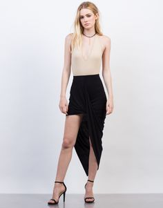 A twist to a simple skirt. The black Draped Asymmetrical Skirt is made from a soft and stretchy material. Pair with our Knotted Halter Crop Top and some lace-up heels for a girls' night out.