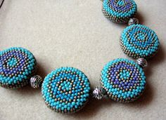 Beaded Bead TUTORIAL Circular Round Peyote.  Foreign, Hungarian I think, but pics are excellent.  Free