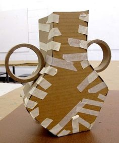 Vases using recycled board, chipboard, and making tape. Good idea for smaller models befor building the real thing.