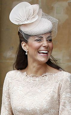 Veiled Beauty from Duchess Catherine's Hats & Fascinators  This feminine Jane Taylor fascinator goes above and beyond with a netted veil and (literally) over-the-top layered details.
