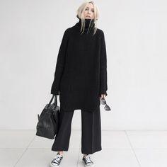 Oversized black waffle knit jumper, wide leg cropped culotte trousers, black bag