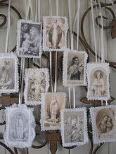 Antique holy cards display