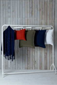 Love how these cushions are displayed. Great displaying idea for market/shop or photo - painted trouser hangers from Ikea on a cheap rail! Craft Stall Display, Craft Fair Displays, Store Displays, Display Ideas, Christmas Market Stall, Craft Stalls, Lifestyle Shop, Consignment Shops, Interior Photography