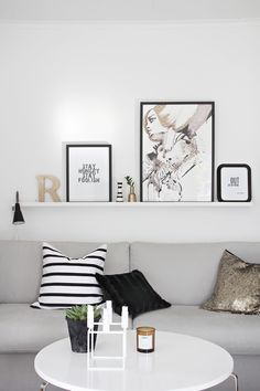 A cheap way to decorate with your favorite framed photos or framed art. Picture ledges from Ikea. Easy to change when you get bored...