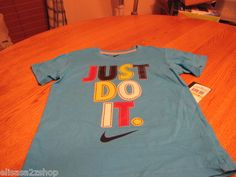 Mouse over image to zoom  Have one to sell? Sell it yourself  Boy's youth Nike T shirt current blue raised print Just do it. NEW TEE 2 toddler