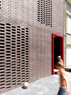 love the idea of these openwork bricks with window glass behind them on the side of the house facing the street. via OWI // Office for Word and Image