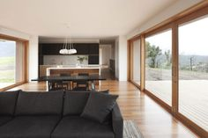 Like windows on both sides of open plan living area. Like timber frames and kitchen/dining/living layout