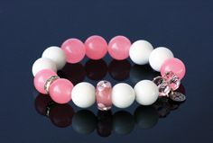 Amazing Fashion Mala, designed with natural White and Pink Jade stones, combined with stunning Murano glass bead decorated with clear crystals. Size of  stones - 12 mm WHITE JADE - Jade is said to bless. White Jade filters distractions, pulls in relevant, constructive information and aids in decision making.  PINK JADE - It is considered a gentle healer with positivity and the ability to rid the body of toxins. It encourages love, wealth and protection.