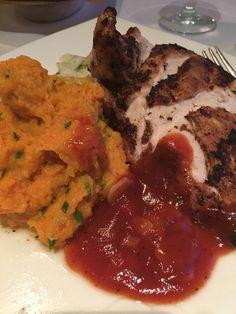 Try the Jamaican Jerk Chicken at WaterScapes Restaurant.