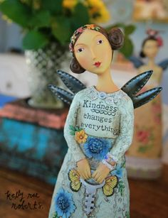 Meet our new Kindness Changes Everything figure! I love love love her details, the sweet blue flowers on her dress and flowers in her hair. She's gorgeous, friends. Get yours here. It's important to note that for some reason, she has a blue tone in these images but in real life, she's cream toned, not blue :)