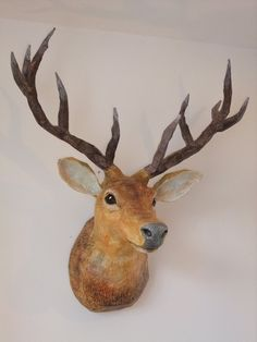 A realistic paper mache mounted deer... to get the look without killing one!