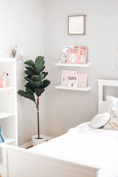 DIY IKEA HACK! Click thru to read how I designed my girls shared bedroom. Ikea | Kallax | Book Shelf | Toy Storage | Play Room | Reading Nook | Fiddle Leaf | Hemnes nightstand | Hemnes bed | Bedroom | Toddler | Home Decor | Home Design | Hemnes Twin Bed | Single Beds | Girls room | Girls Bedroom | White Bedroom | White furniture | Minimal | Minimalist Design | Pink | Blush | Rustic | Shabby chic | Simple | Neutral | Modern |