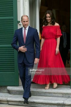 For a birthday party celebrating the Queen, Kate switched into a red Alexander McQueen dress with off-the shoulder sleeves. Photo: Getty Images The Duchess debuted a variety of new looks in Europe. Alexander Mcqueen Kleider, Alexander Mcqueen Dresses, Looks Kate Middleton, Prom Dresses, Summer Dresses, Long Dresses, Dress Long, African Dress, African Fashion