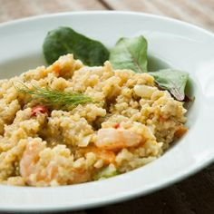 Baked quinoa with shrimp and veggies in a light cheese sauce