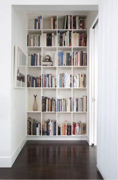 bookcase wall-such a practical use of space!