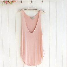 Raw Edge Layering Tank in Peach ! So cute! NWT! ~ Raw Edge Layering Tank in Peach! So cute! This Tank has a deep V in the front that is perfect for layering things underneath it for that cute layered look! Use it as a vest or a tank top! Curved bottom hem and raw edge stitching! This is a perfect piece to have in your wardrobe to use as a staple layering pieces!  WENXI Tops Tank Tops