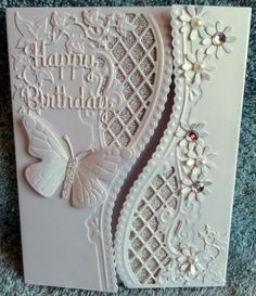 "Card Stock: White Pearlised Card from PayPer Box Silver Non-shedding Glitter Card from B&M Dies: Marianne Designs Anja Edge Marianne Designs Ivy Corners Joy! Craft Butterfly Set Spellbinders Sentiments 1 ""Happy Birthday"" Woodcraft Daisy Punch Embellishments: Pearl & Bling from stash"