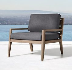 RH's Ciel Lounge Chair:Our collection's slender silhouettes embrace the structural elegance of 1950s Danish Modern design, expertly reimagined by New York designer Brad Ascalon. Crafted of premium teak, the clean, low profile and purposeful tension between sleek angles and rounded lines yield the perfect modernist balance of function and beauty.
