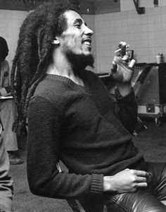 """""""Bob Marley style. Rasta""""~ same sweater seen in other pix. Love the texture and v-neck. Cannot ignore the leather pants and hope to find a picture where his pants are more visible. The simplicity of his sweater lets his beauty and dreads stand out. Perfect outfit."""