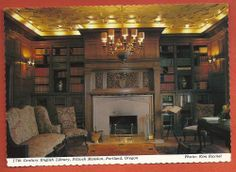 A vintage postcard from the Pittock Mansion located in Portland, Oregon. This is the Library which features the Pittock Family Crest, two sets of carved pocket doors, and indirect lighting. This postcard is no longer available.