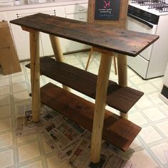 Rustic sofa table. Reclaimed barnwood planks with peeled lodgepole pine legs. Wyoming rustic furniture.