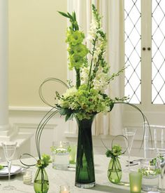 Green white roses and orchids in a centerpiece Gladiolus Bouquet, Gladiolus Arrangements, Modern Floral Arrangements, Bride Flowers, Flowers For You, Flower Bouquet Wedding, Green Orchid, Green Flowers, Green Centerpieces
