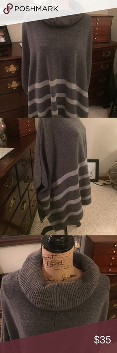 Banana Republic poncho sweater Super cute with jeans/leggings.  Only worn a few times so in excellent condition.  Keeps you comfy warm. Banana Republic Sweaters Shrugs & Ponchos