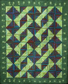Tad. Our oldest grandson graduated high school in 2007.  His favorite color is green,  this is his graduation quilt. Is enrolled at UNI, with thoughts of being a high school history teacher or 3rd grade. Great stash buster. No pattern