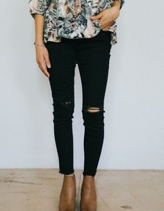 black ripped jeans and floral top