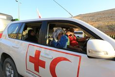 A man and his wife in an IFRC vehicle being evacuated from Mouadamia to a suburb of Qudsaya during a cease-fire when a safe passage was esta. Medical News, Red Cross, Van, Fire, Vehicles, Vans, Car, Vehicle, Tools