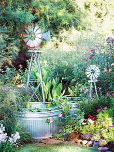 Dream Water Gardens...Down on the Farm  Galvanized stock tanks, which typically hold water for livestock, are perfect for an easy-to-build water feature. Ornamental windmills spin in the breeze, complementing the farm feel of the tanks.