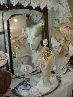 antique mirror display with pin cushion doll